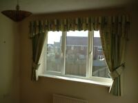 Nice pair of lined green Curtains