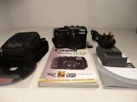 For sale, Canon G12. Camera is in mint condition. Also comes with a few extras.