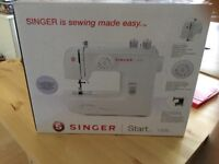 Brand new never opened Singer Sewing machine