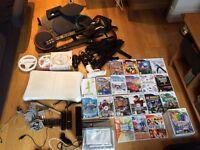 Wii Bundle - 26 games, 3 microphones, 2 guitars, drum,2 wheels, balance board