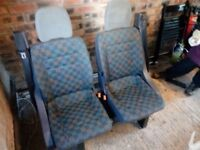 Van seats with safety belts