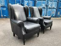 Black leather armchairs possible delivery