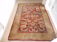 Large thick wool rug in red and golds