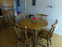 Circular Wooden Table and 4 Chairs