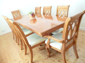 Solid wood extending dining table and eight 8 chairs