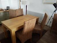 6 seater Mango wood table and 4 wicker high-backed chairs