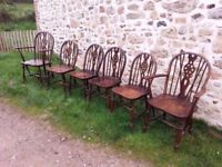 SIX OAK WHEEL BACK DINING CHAIRS INCLUDING TWO CARVERS