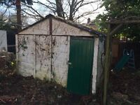 Concrete garage with water tight asbestos roof.
