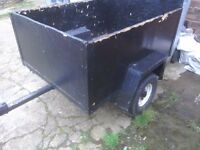 A car trailer with leaf springs rear lights highe sides tex