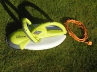 Garden Groom hedge trimmer with extension collection bag.