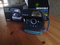 Poloroid camera - Polaroid 600 round
