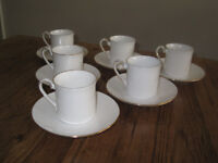 6 fine quality Queen's coffee cups and saucers. White china with gold rims.