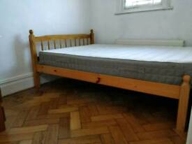 URGENT - Pine double bed and 2 year old ikea mattress