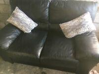 Gorgeous deep cushioned quality black leather sofa