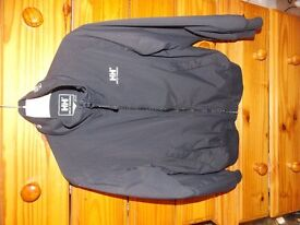 BoysBoys Black Helly Hanson shower Jacket with Zip up pockets and inside zip up pocket Age 10yrs