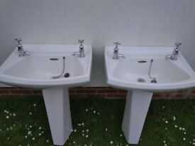 Pair of pedestal wash basins including taps and drain fittings