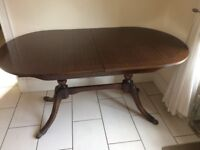 Mahogany Dining table, perfect condition, extra leaf will seat 8 comfortably