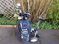set of golf clubs with bag and trolley