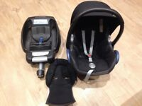 Black Maxi cosi car seat group 1 and an easy fix base.