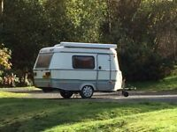 Eriba Puck caravan with awning and safari room