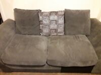 Gray sofas and swivel chair