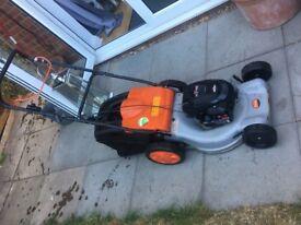 petrol lawn mower flymo