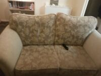 Cream patterned sofa and chair