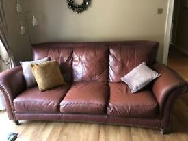 Large leather sofa and single chair