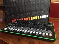 Roland TR-8 drum machine with 7x7 expansion
