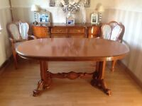 Table and chairs and cabinet in beautiful condition