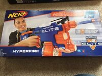 Selection of NERF guns and toys