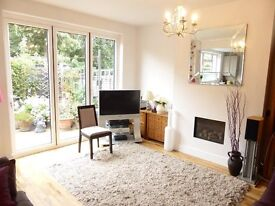 Two bed garden flat, fitted kitchen with built-in appliances near trains, buses and shops