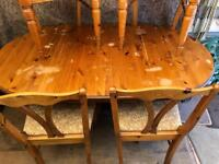 Pine drop leaf table and four chairs