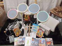 Nintendo Wii + Wii Fit/Balance Board + Rock Band + Guitar hero