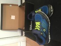 Nearly new size 1 Wilson runners