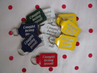 NEW 14 'Caught Being Good' leather-effect key rings in white, yellow, green, blue & red. £1.25 lot.