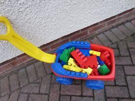 Kids trolley full of Mega Bloks bricks
