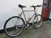 Gents Raleigh multi-geared bicycle. Used very little due to illness. Excellent condition.