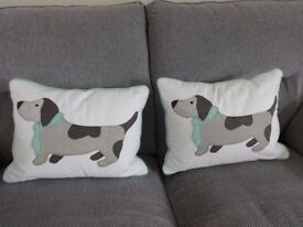 Dog in a tie cushions x 2. Fab condition, hardly used! 12.5 inches x 16.5 inches.
