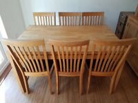 Solid oak dining table and chairs and matching sideboard