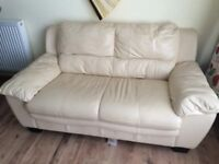 cream leather sofas. £100