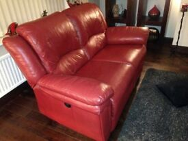 Both a 3 seater and a 2 seater red leather sofas