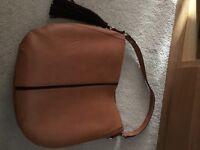 Large tan coloured bag