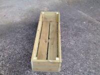 Wooden decking planter. Size is 1.20m