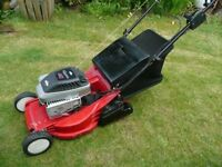Self drive lawnmower with roller