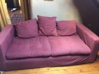 Two purple 3 seater sofas