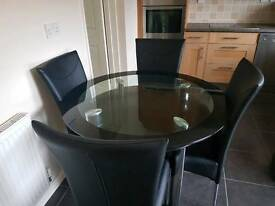 Black glass table and 4x leather chairs