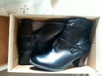 Brand new black size 5 boots