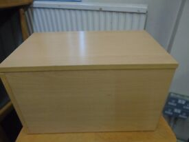 small pine look filing cabinet.