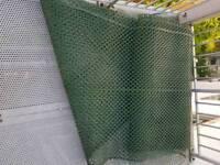 Loads of green plastic gardening fencing